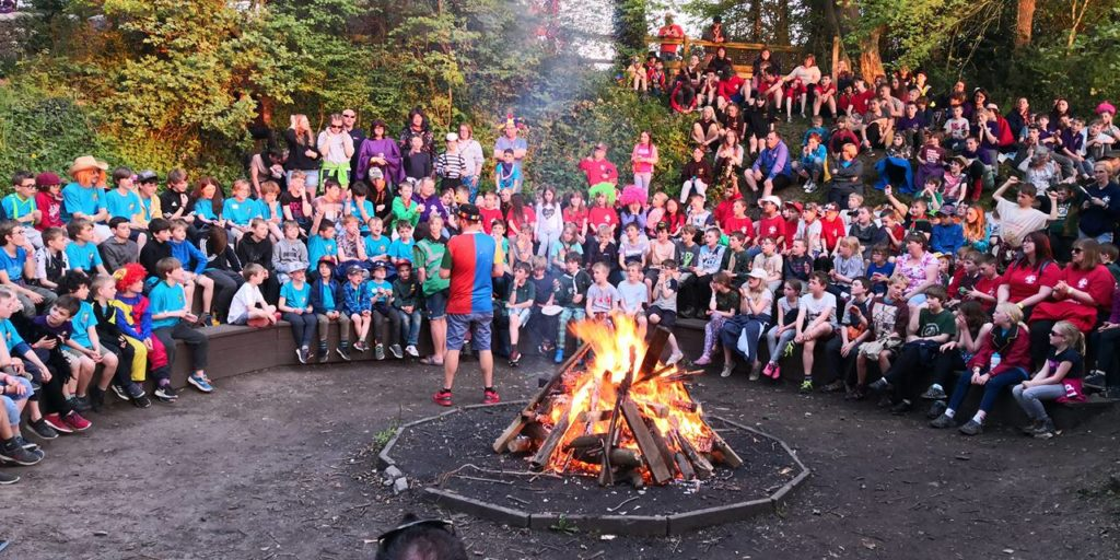 beavers and cubs around a camp fire