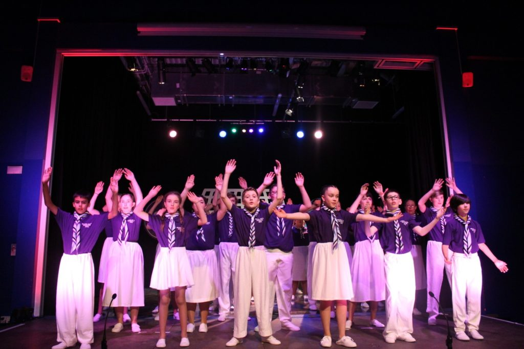 gang show cast in musical scene costumes